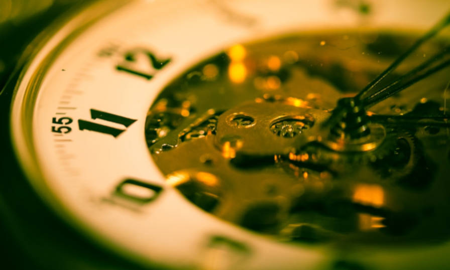Decorative close-up image of an old pocket watch.