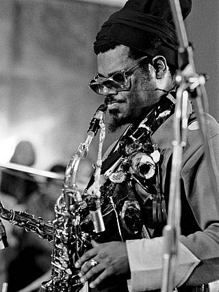 Rahsaan Roland Kirk playing a saxophone.