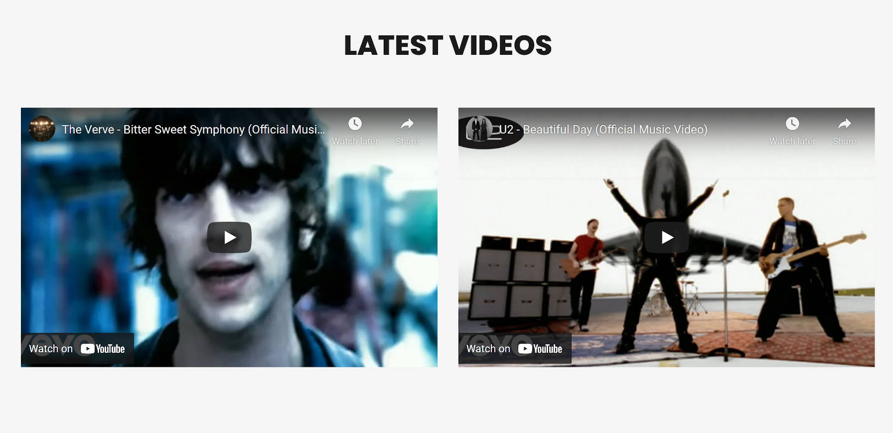 A section with two columns, each with an embedded YouTube video.