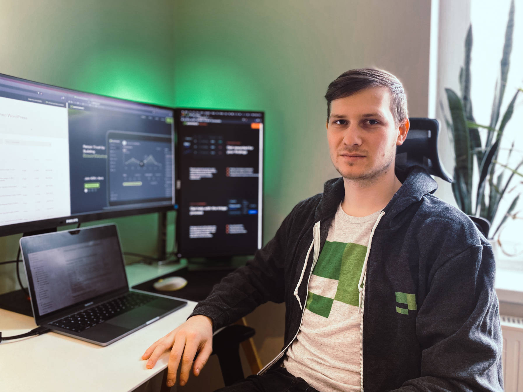 Patchstack founder and CEO, Oliver Sild, sitting at a desk with laptop and monitors.