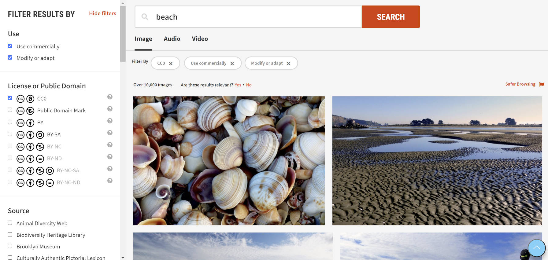 Image search results for beach photos on CC Search.